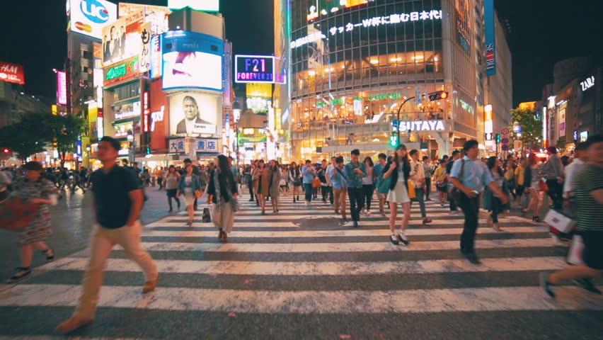 TOKYO - JAPAN, MAY 25, 2014: People crossing the...