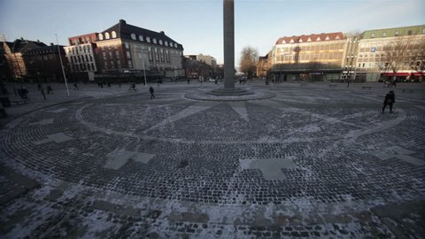 """TRONDHEIM, NORWAY, JANUARY 2014 Aerial drone shot over the Oav Tryggvason Monument and """"Torget"""", the central square in Trondheim, Norway."""