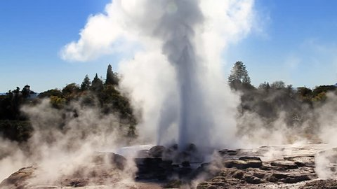 Slow motion: The Pohutu Geyser (right) and Prince of Wales Feathers Geyser (left, smaller) erupting at Whakarewarewa Thermal Park, Rotorua, New Zealand - one of NZs top tourist attractions. Wide.
