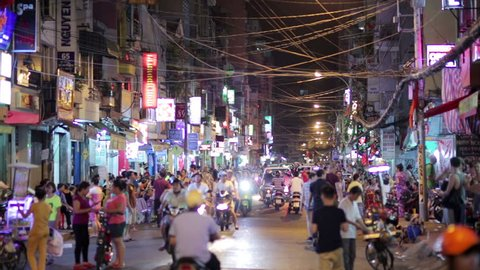 SAIGON, VIETNAM - MAY 2014: Nightlife with bars and pubs, Pham Ngu Lao Street