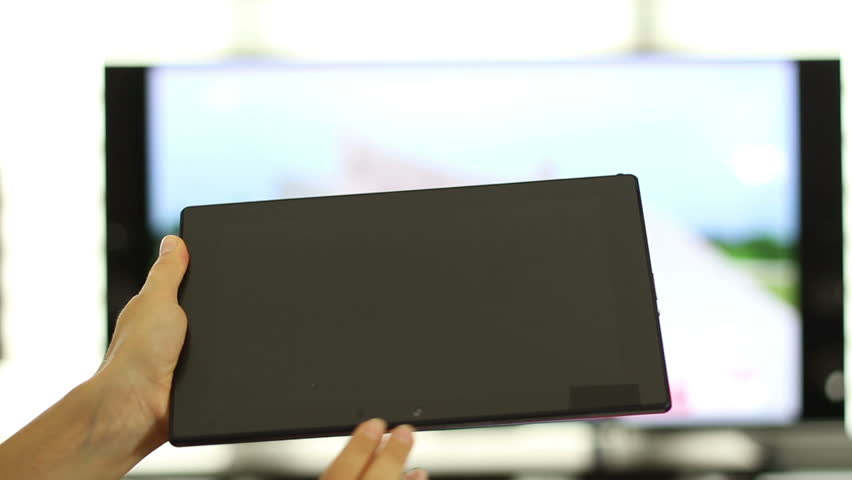 Using tablet pc in front of tv, close up | Shutterstock HD Video #6998800