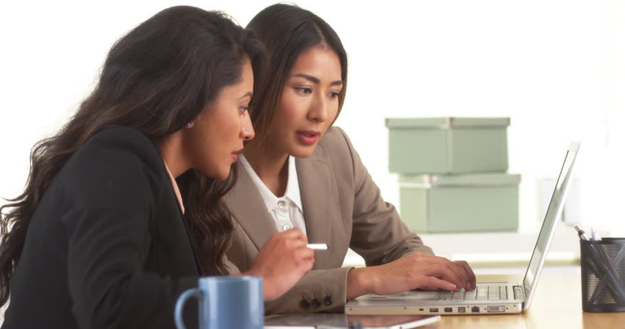 Mexican and Japanese businesswomen working on laptop | Shutterstock HD Video #7006720