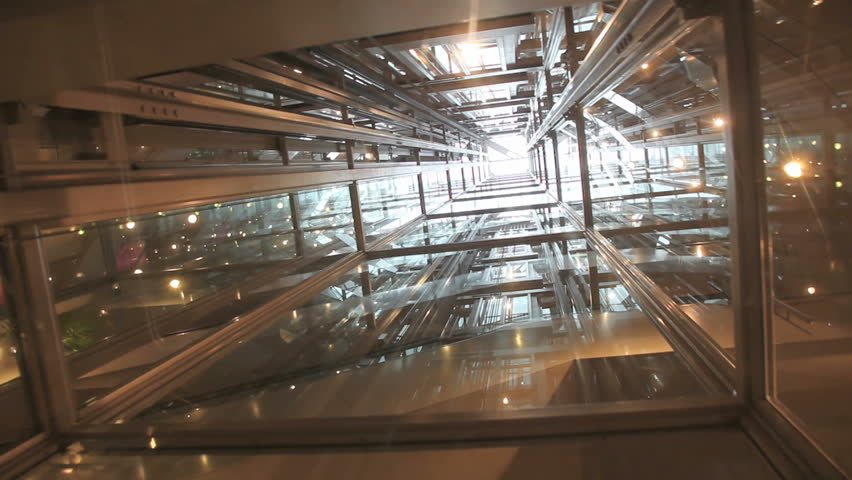 Ride in a transparent glass elevator going up
