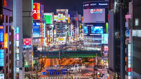 TOKYO, JAPAN - MARCH 19, 2014: Shinjuku district illuminated at night. The district is a renown night life center.