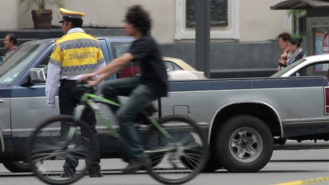Mexico City, Mexico-CIRCA June, 2014: Full shot Police directing traffic. Nowadays exist a lack of credibility in Mexican police due their bad procedures and extortions.