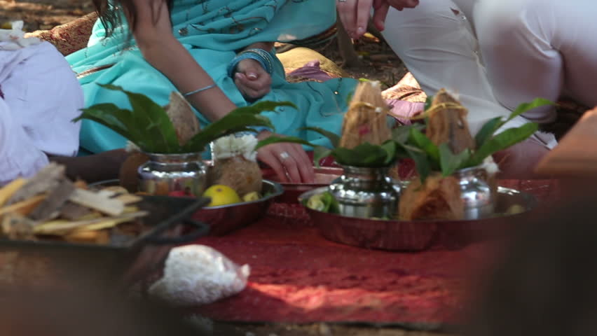 Bride And Groom Perform The Rite Next To Accessories That Are On A Blanket Indian Wedding Ceremony Coconuts Fruit Rice Stock Footage Video