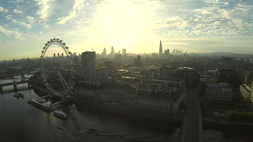 Aerial panorama of central London, UK. Features the River Thames, Millennium Wheel (London Eye), Waterloo and Houses of Parliament.