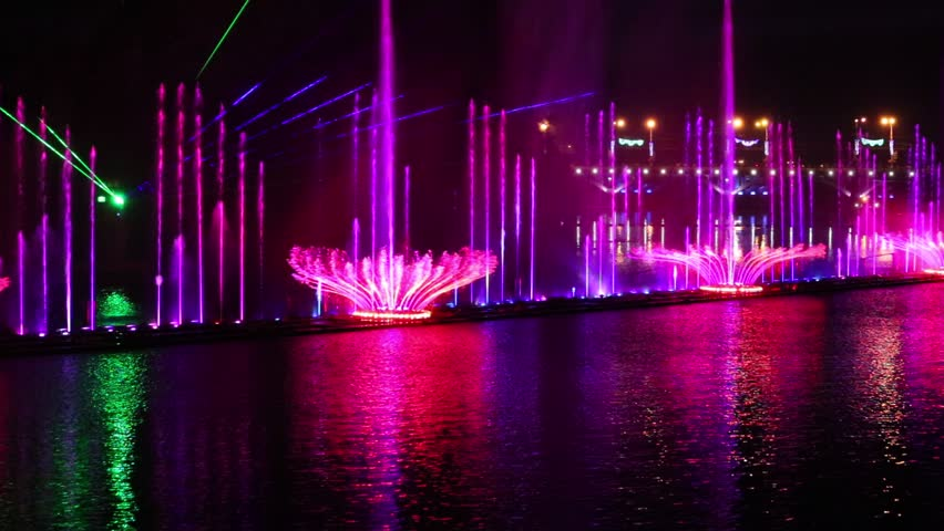 Colored Water Fountain At Night Stock Footage Video