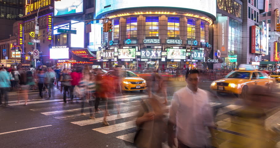 NEW YORK - CIRCA AUGUST 2014: Crowd of people crossing street intersection time-lapse Times Square at night | Shutterstock HD Video #7181260