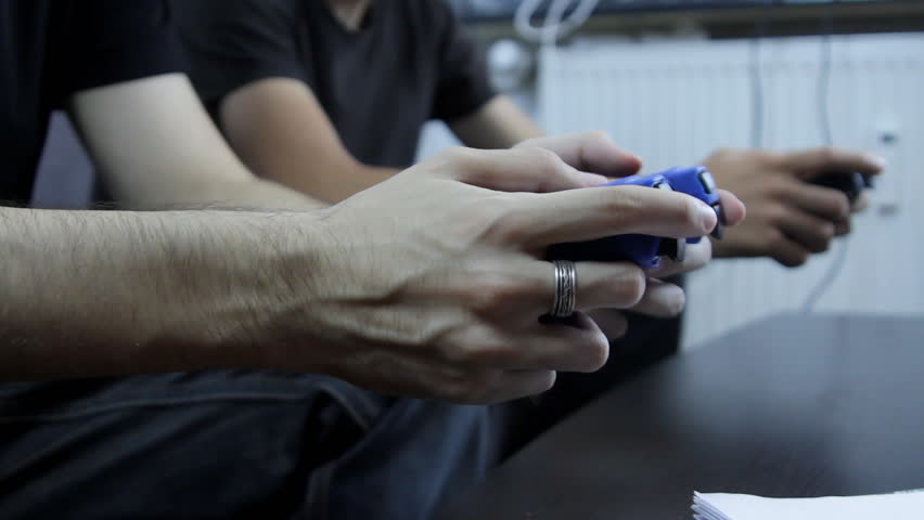 Lazy College Boys Playing On A Game Console, Hands Detail, Side Shot | Shutterstock HD Video #7195420