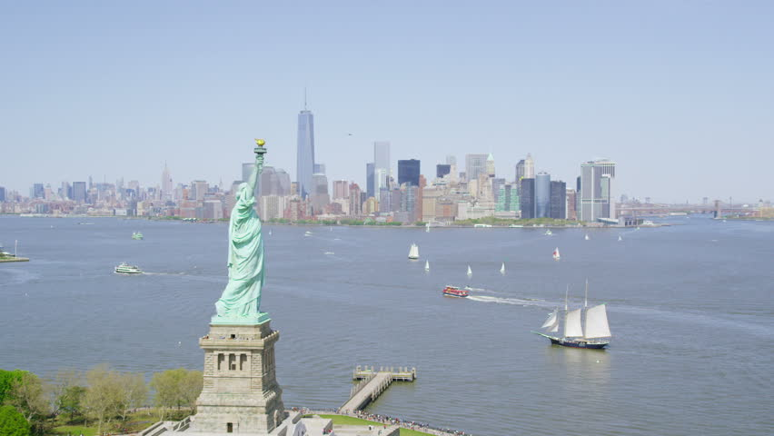 Helicopter aerial view of  Statue of Liberty, New York City State.  Flying overhead we see the iconic American Lady Statue. Famous United States tourism attraction. | Shutterstock HD Video #7198621