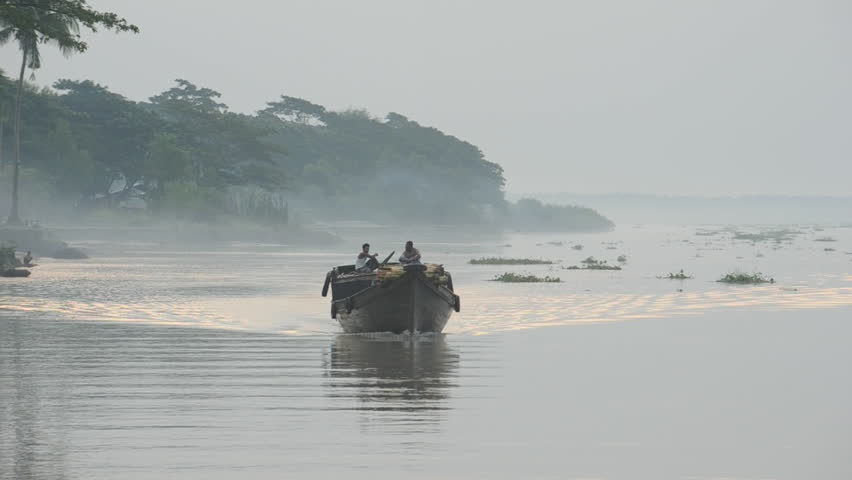 BANGLADESH - Oct 2010: View of boat in flooded river #7279390