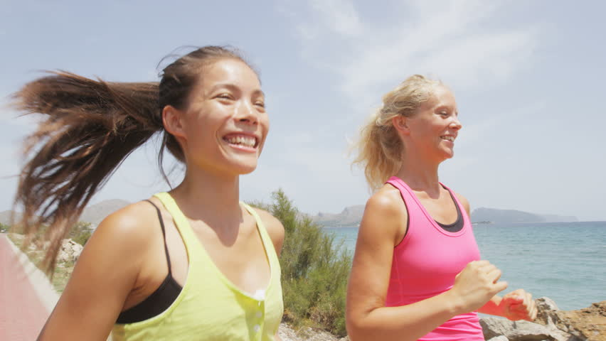 Running Women Exercising Jogging Happy On Beach Training As Part Of Healthy Lifestyle Two Fit