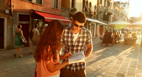 Italy Vacation Woman Asking man for Directions Sun Flare Travel Concept
