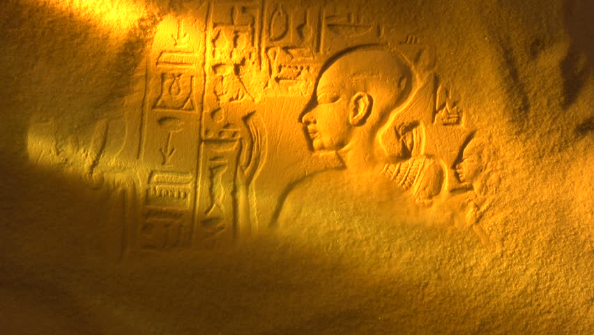 Desert sand blows away to reveal ancient Egyptian Hieroglyph, shot in studio NOT computer generated