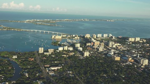 Sarasota, Florida 4k aerial, early morning light, looking towards gulf. Building just catching the morning sunrise.