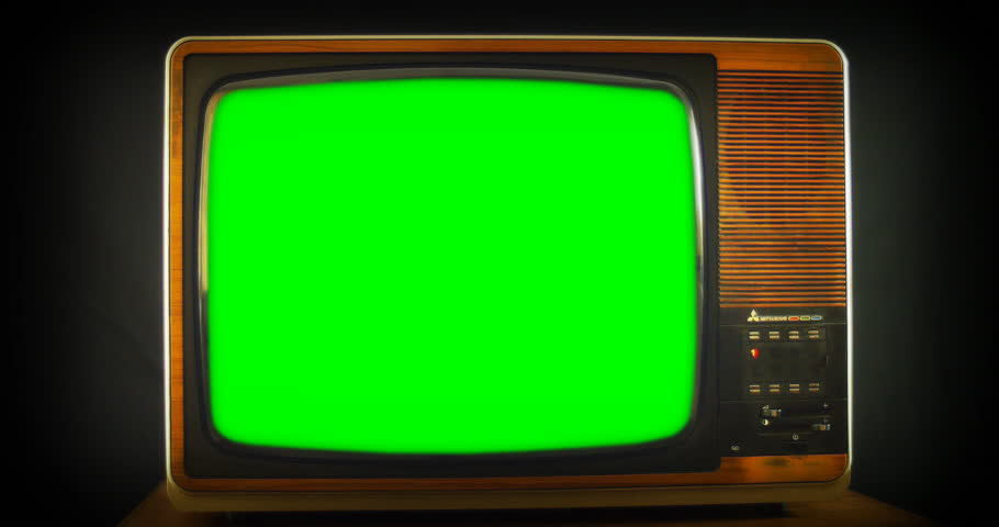 1970s Vintage television with green screen. 76 years of television history came to an end at midnight on Wednesday 24 October 2012 when the analogue TV signal was switched off. (UK, July 2014)