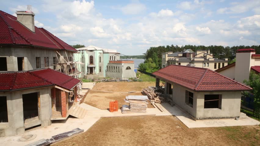 Some Houses Under Construction And River Away At Summer Day   HD Stock  Footage Clip
