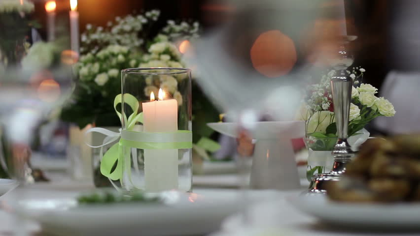 Burning candle in a glass flask on a festive table | Shutterstock HD Video #7477801