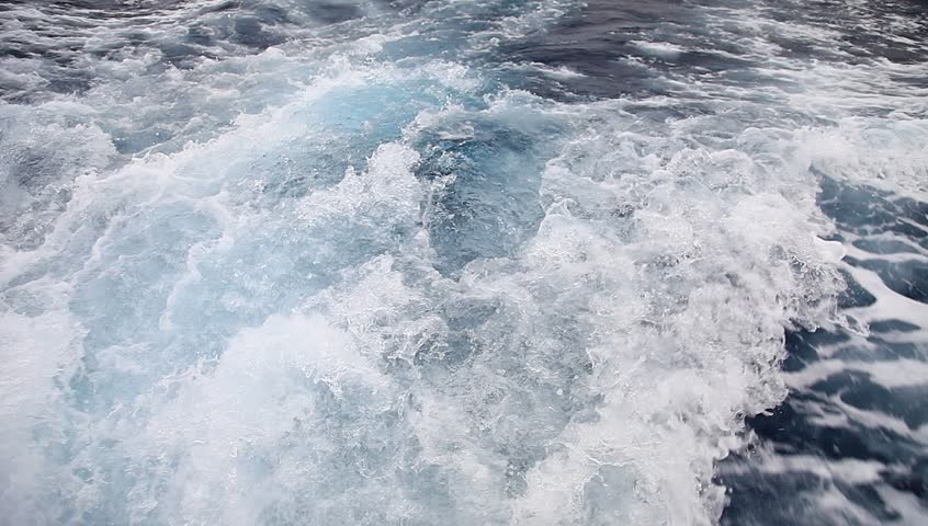 waves at the stern of the ship sailing on the sea