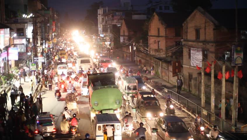 KATHMANDU, NEPAL - OCT 25: The nightlife on the streets at Thamel, Nov 30, 2013 in Kathmandu, Nepal. People, cars, motorbikes and rickshaws on the street