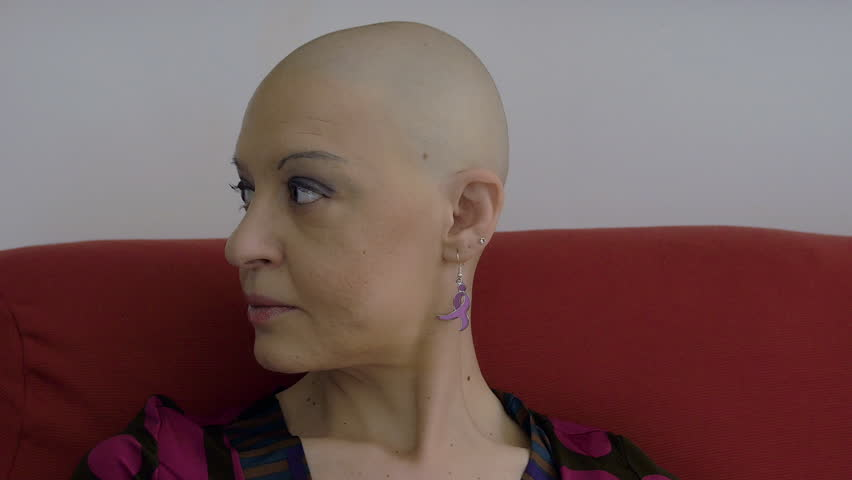 cancer sitting on the couch: bald, loneliness, courage, faith, dise