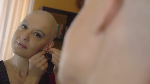 happy woman after chemotherapy wearing earrings