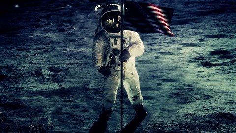 Astronaut with flag on the surface of the moon