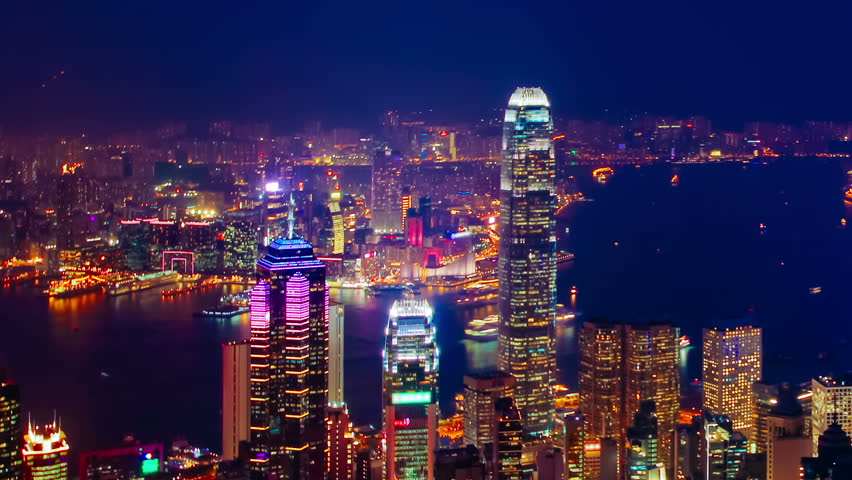 Blue hour time-lapse of Hong Kong, seen from The Peak and depicting Central, Admiralty, Wan Chai, Causeway Bay, Kowloon and Tsim Sha Tsui - pan movement.