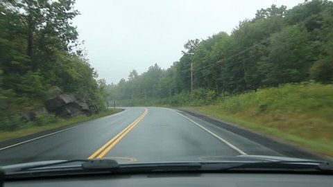 Driving POV in Muskoka. Misty rural corner. Driving on a misty morning. Corner and straightaway on Highway 141 in Muskoka, Ontario, Canada. Pickup truck and car approach in the other lane.