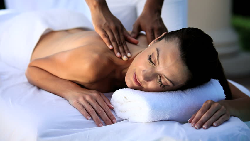Sophisticated lady having massage treatment at a luxury health & beauty spa