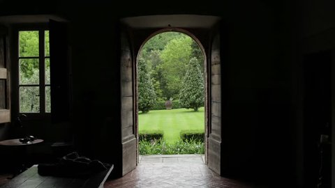 Gliding out from inside an old Italian villa revealing its garden.