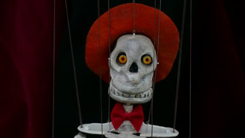 Dancing skeleton marionette puppet close up. Puppet created by puppeteer.