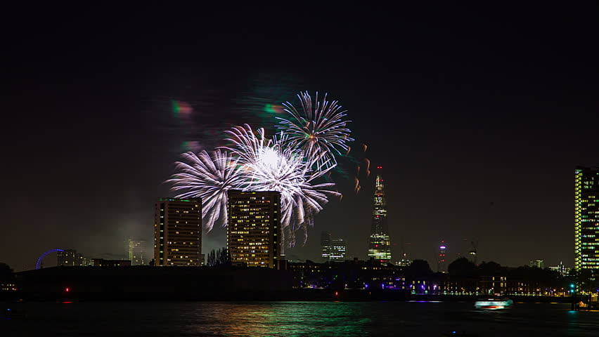 Night time lapse of fireworks, the Shard and river Thames London, UK