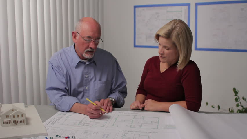 A man and woman go over architecture plans, dolly shot | Shutterstock HD Video #764680