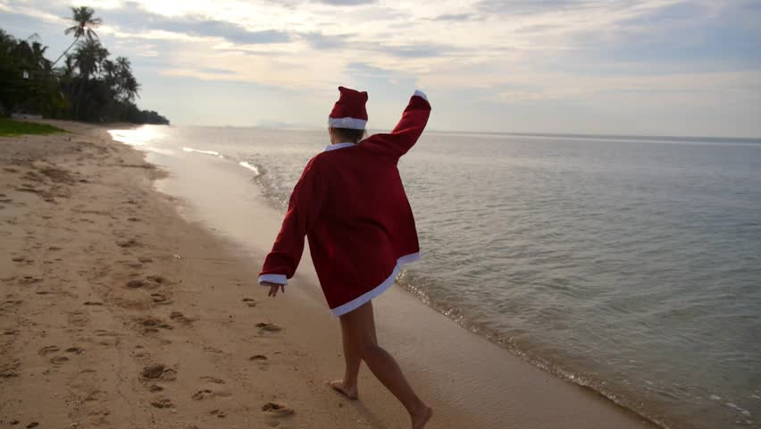 Beautiful Young Woman In Santa Costume On Tropical Beach ...