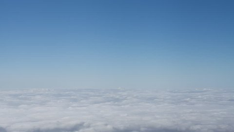 4K time lapse of a bright blue clear sky above a carpet of white inversion clouds isolated in the sky