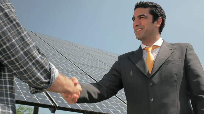 Handshake between electrician and engineer in solar power station (series)