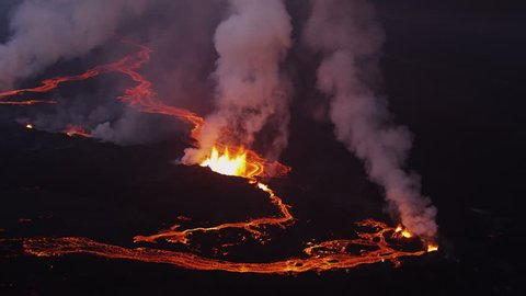 Aerial night volcano lava Holuhraun magma land fissures seismic activity hydrothermal heat steam gas cloud Iceland RED EPIC