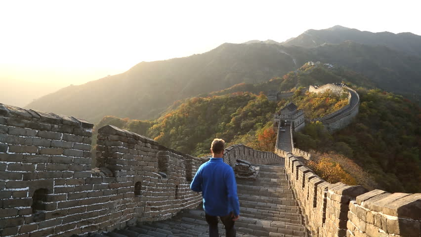 Great Wall of China male walking on the historic fortified wall between watch towers Mutianyu nr Beijing, China, Asia