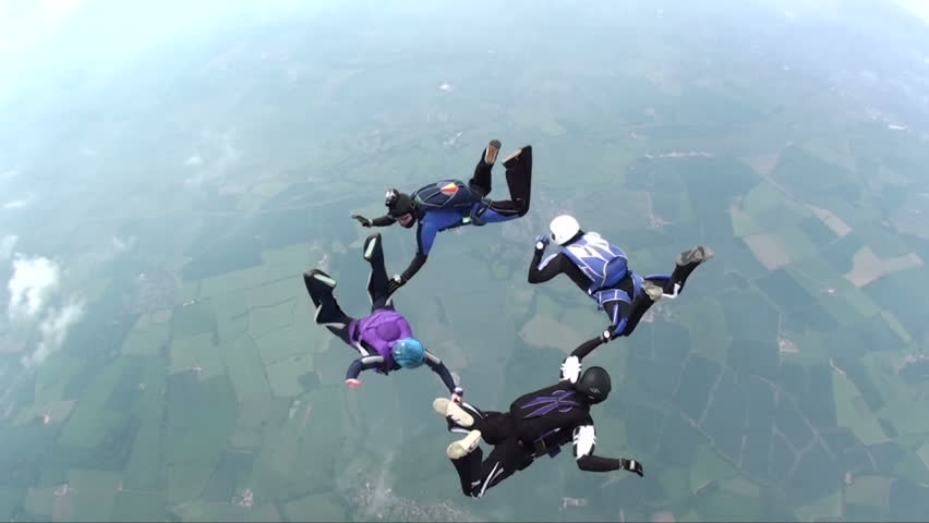 Four skydivers in freefall doing formations | Shutterstock HD Video #771970