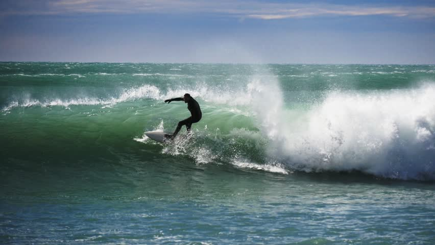KAIKOURA, NZ - OCT 3 2014:a surfer rides a wave at a point break near kaikoura in new zealand- recorded at 1080p 60fps | Shutterstock HD Video #7750750