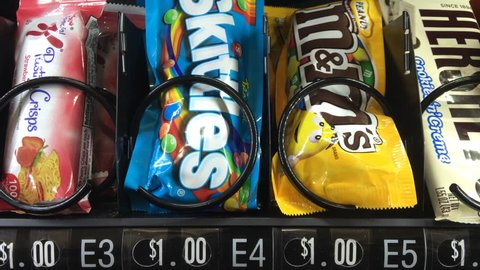 USA - OCTOBER: Chocolate candy coming from vending machine, a typical daily snack of someone in the United States of America, taken in October 2014.