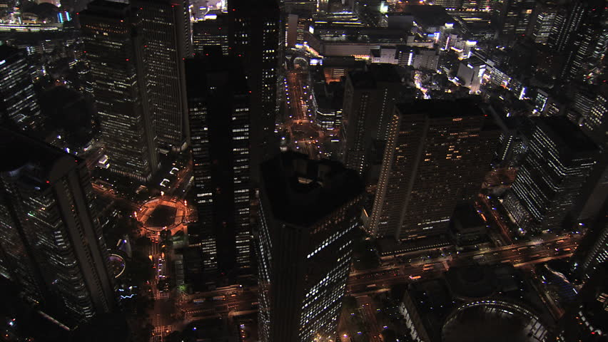 Aerial Metropolis Tokyo night illuminated city offices skyscrapers city blocks traffic structure growth transport Business District Japan Asia | Shutterstock HD Video #7792918