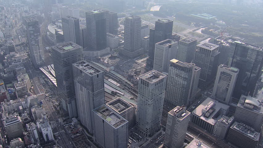 Aerial zoom view Tokyo City Rail Station Marunouchi business office district served by Shinkansen high speed rail Japan