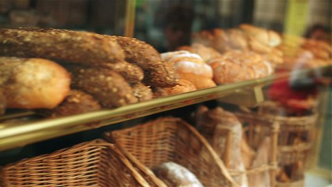 Freshly backed breads in bakery, steadycam shot