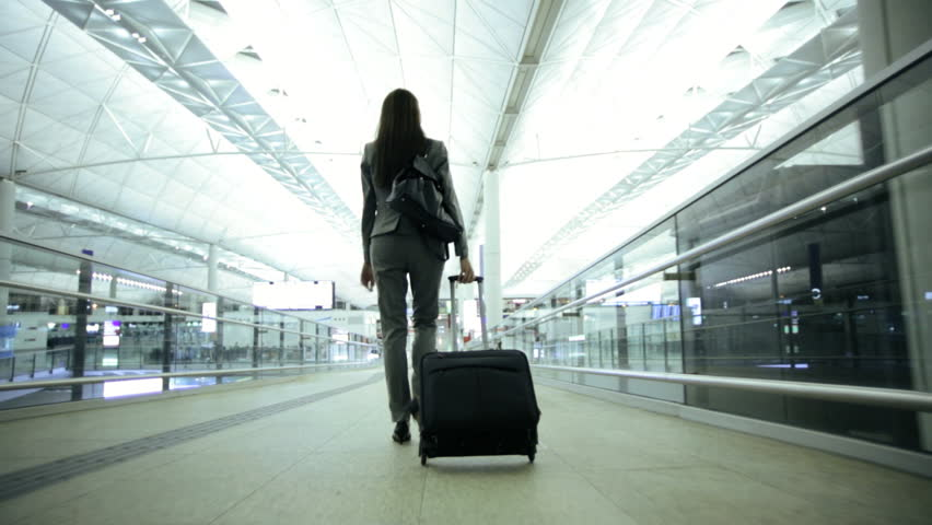 Smart Asian Chinese female financial consultants city airport travel tourism conference baggage departure destination corporate business | Shutterstock HD Video #7810090