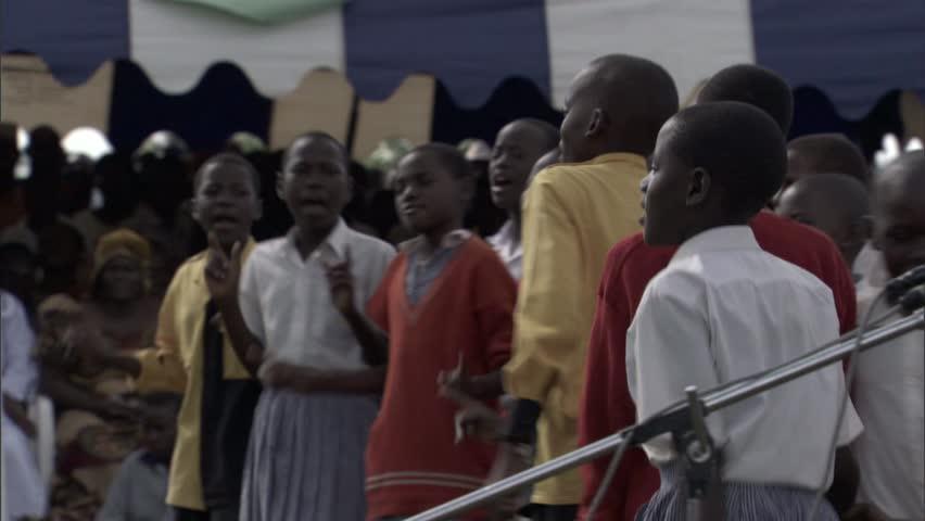 Children sing and dance in celebration of new water tap in Uganda, | Shutterstock HD Video #7822486