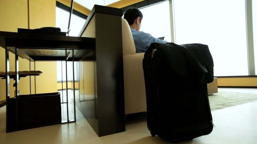 Young Asian Chinese male luxury hotel accommodation hospitality room relaxation wireless touch screen tablet business travel | Shutterstock HD Video #7839010
