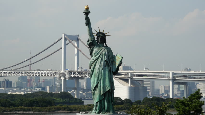 Tokyo Japan Circa September 2014 Replica Statue of Liberty with Peace Bridge in the Background  -  Tokyo Japan Circa September 2014 | Shutterstock HD Video #7844200